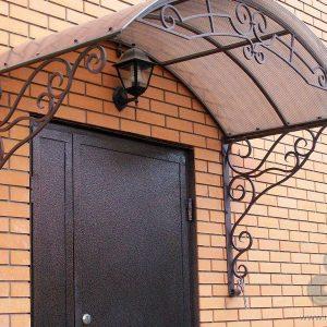 Кованые козырьки Кованый козырёк над дверью Арт. К-004 Norkovka